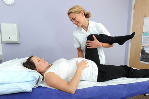 Osteopath treating a pregnant lady