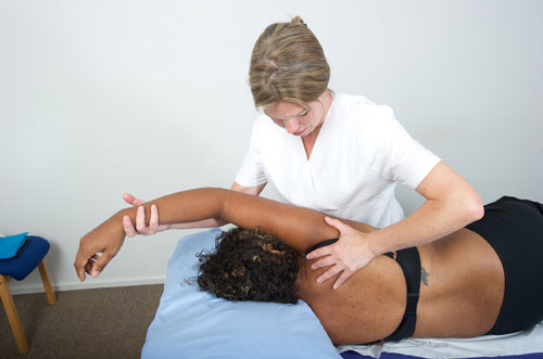 Osteopath assisting with someone's work-related problem
